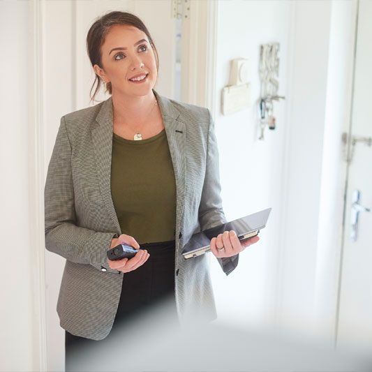 Smart lady with a clipboard in a house
