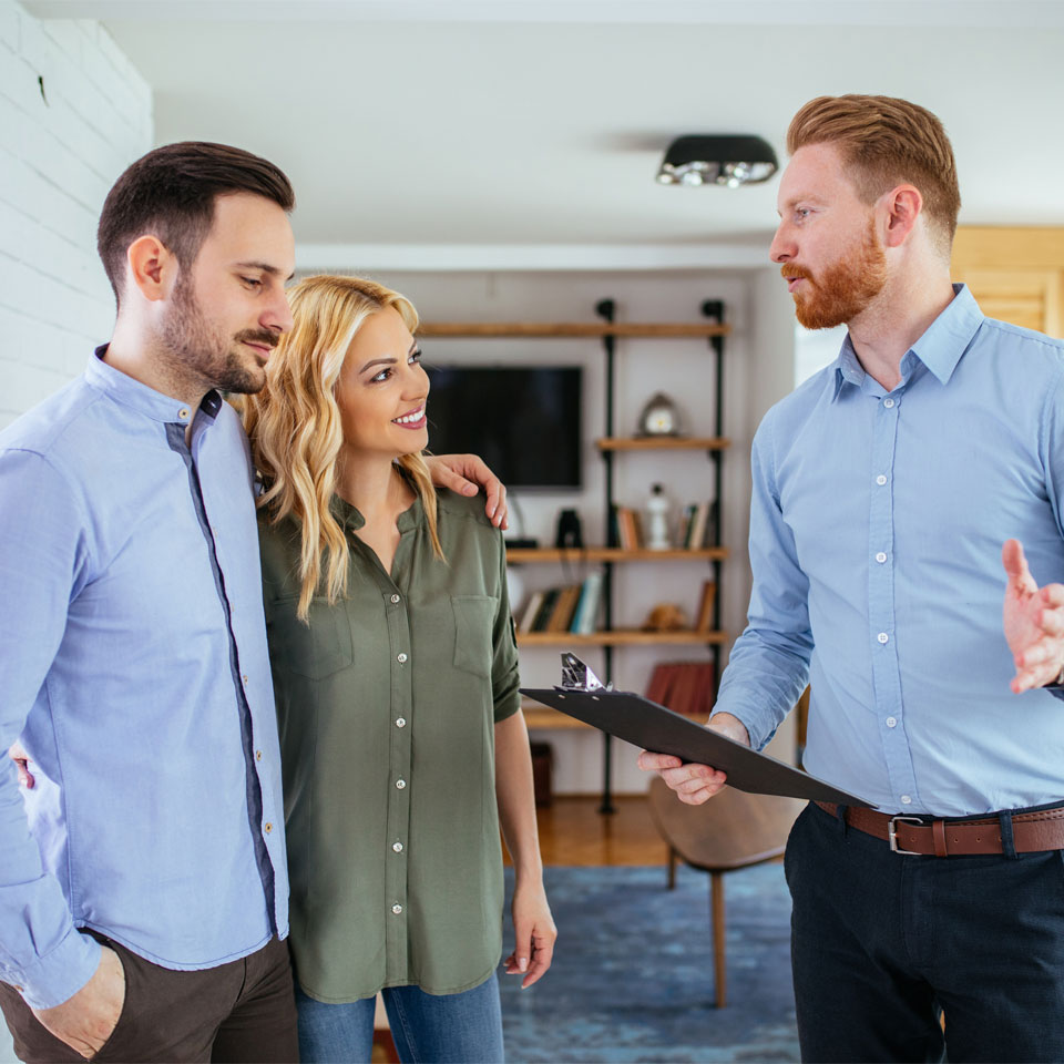 Man and woman having a home consultation with a professional.