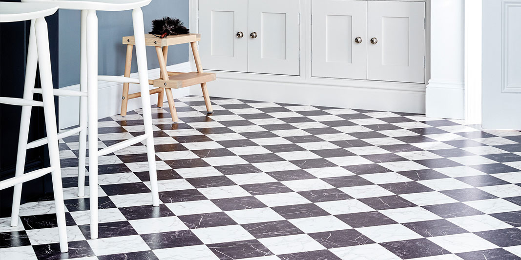 Black and white checkered flooring in a kitchen